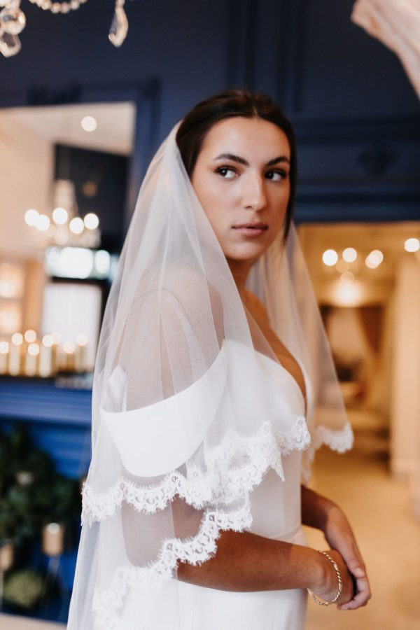 This 2 Tier Veil in Classic Tulle, decorated all the way around both Tiers with Catherine Lace is available now. Click to shop.